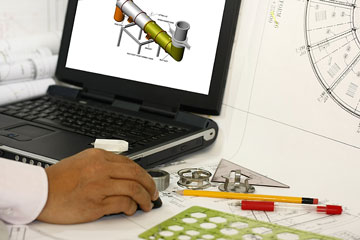 a draftsman using a computer aided design system